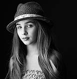 Black and white contempory portrait of young girl.