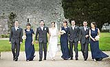 Bridal party sharing a joke at the beautiful wedding location of Castlemartyr, Co. Cork, Ireland.