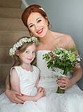 Bride with beautiful little flowergirl at home before they leave for the church in Limerick.