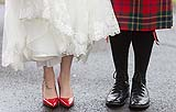 Bride's red shoes compliment the groom's red kilt at their wedding at St. Mary's church Limerick.