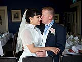 Groom kisses his new wife after their wedding at the Mustard Seed Restaurant, Ballingarry. Co. Limerick, Ireland.