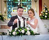 Bride and Groom lighting candles at wedding in Douglas Church, Co. Cork, Ireland.