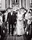 Bride and Groom walking down the aisle after they were married at Douglas Church, Co. Cork, Ireland.