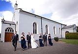 Wedding couple with their bridal party at Douglas Church, Co. Cork, Ireland.