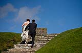 Bride and Groom visit Charles Fort after their wedding at Douglas Church, Co. Cork, Ireland.