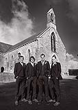 Groom with groomsmen before his wedding in Kilcolman Church Co. Limerick, Ireland.