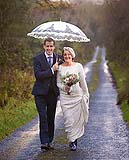 Bride and Groom pose for photographs just before the wedding reception at Ballygarry House, Tralee, Co. Kerry.