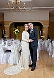 WEdding couple pose for a photograph at their wedding reception at Ballygarry House, Tralee, Co. Kerry.