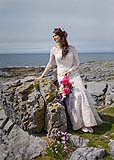Beautiful bride poses for a portrait in the Burren, Co. Clare, on the west coast of Ireland.