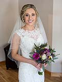 Bride poses for a photograph just before her wedding at AnnaCarriga Killaloe, Co. Clare, Ireland.