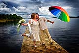 Bride and groom enjoying a fun moment in scenic Northern Ireland.