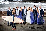Bridal party enjoy photobomber during their wedding photography on Spanish Point beach, Co. Clare
