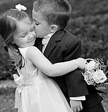 Flowergirl and pageboy hugging at wedding in Co. Limerick, photographed by Cormac Byrne Photography.