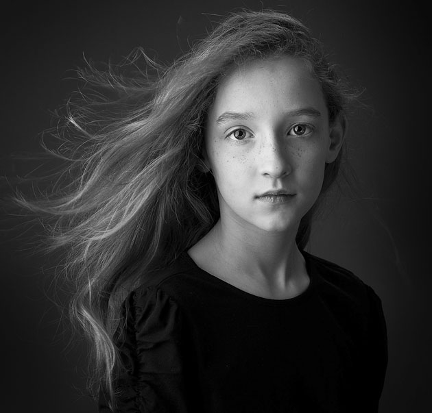 Contemporary black and white portrait of girl taken by Cormac Byrne Photography.