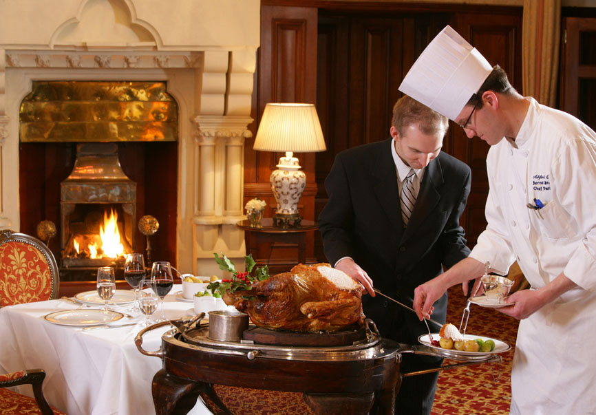 Chef and assistant carving dinner at the George V Dining Room at Ashford Castle, Cong, Co. Mayo.