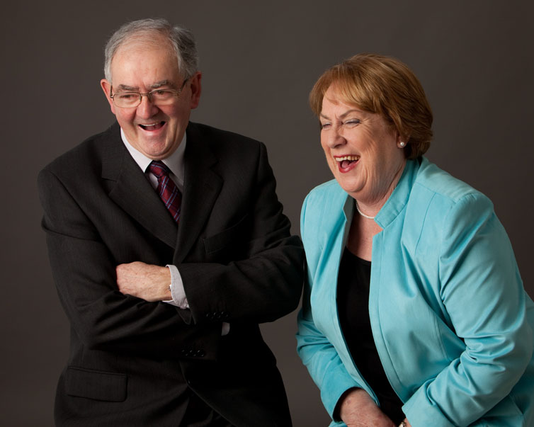 Husband and wife enjoying having their portrait taken at Cormac Byrne Photography
