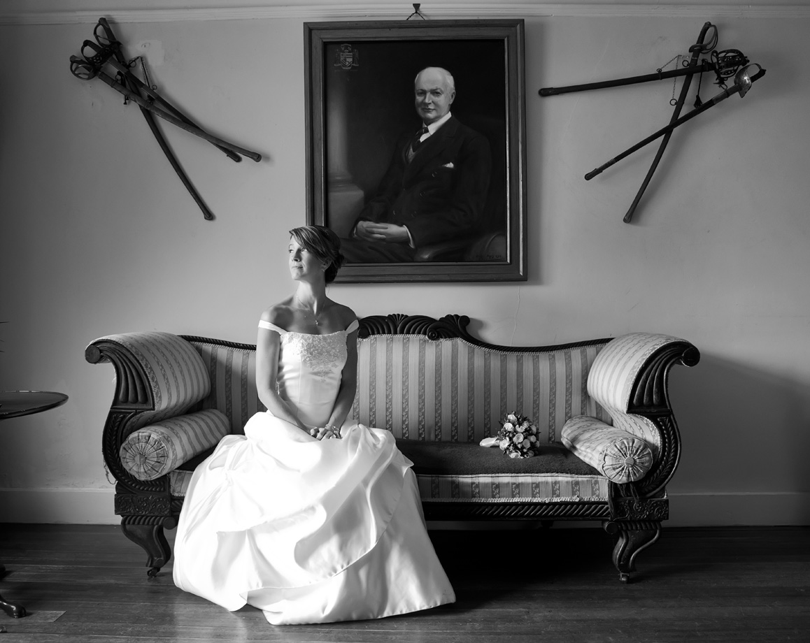 The bride poses for a photograph in Springfield Hall, Broadford, Co. Limerick. Photography by Cormac Byrne