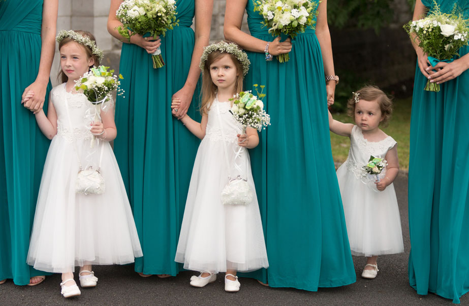 Flowergirls and bridesmaids await the arrival of the bride to be, at St. Mary's church. Limerick.