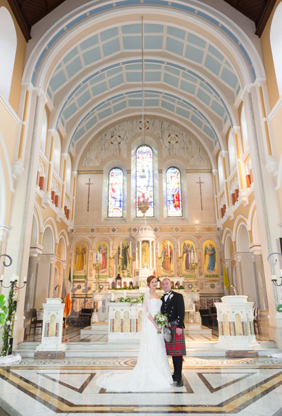Bride and groom on the altar of St. Mary's church, Limerick