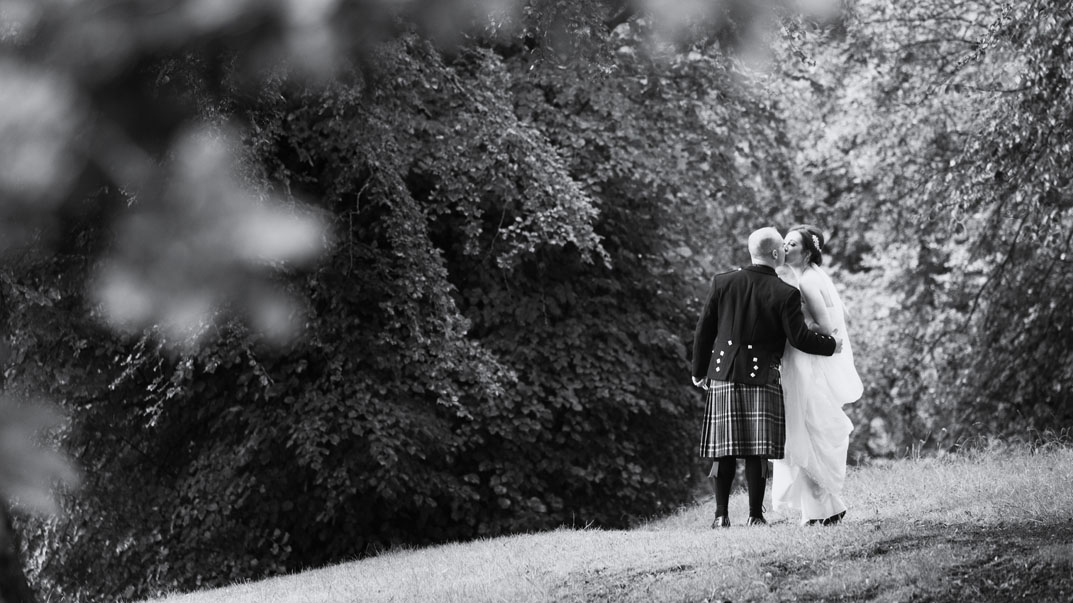 Wedding couple going for a romantic walk on the grounds of the Castle Oaks House Hotel, Castleconnell, Co. Limerick