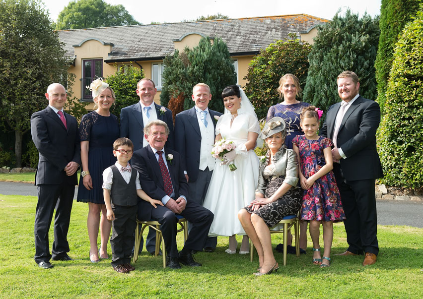 Wedding couple and family pose for family portrait on their wedding day at the Mustard Seed Restaurant, Ballingarry, Co. Limerick