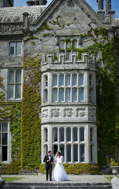 Bride and groom with the backdrop of Adare Manor, Adare, Co. Limerick, Ireland.