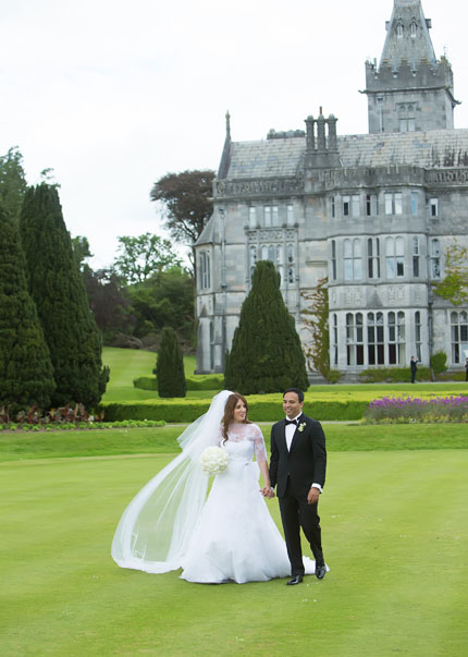 Wedding couple enjoying a romantic walk after their wedding at Adare Manor, Adare, Co. Limerick.