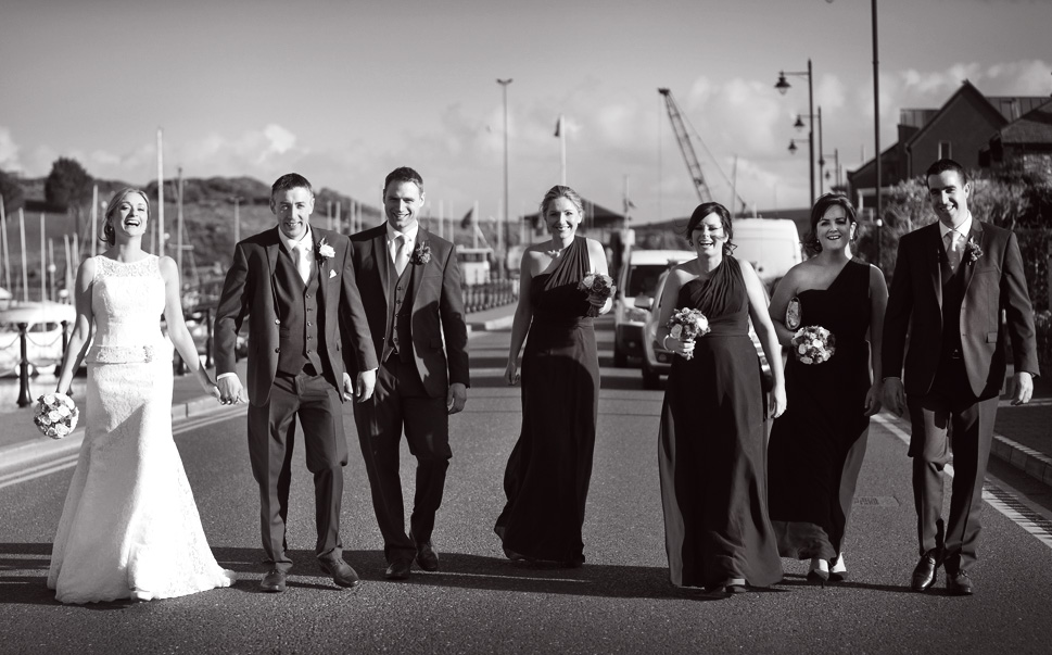 Wedding couple with their bridal party in Kinsale, Co. Cork, Ireland.