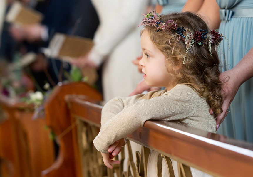 Pretty little flowergirl at a wedding in Kilcolman Church, Co. Limerick, Ireland.