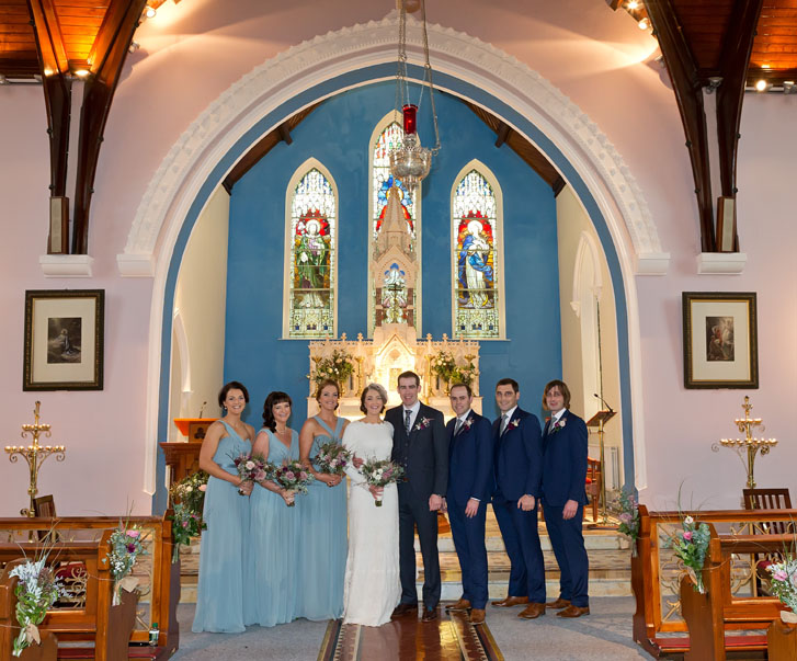 Bridal party on the altar of Kilcolman Church, Co. Limerick, Ireland.
