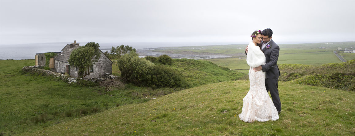 Wedding couple pose for a portrait near Doolin, Co. Clare on the west coast of Ireland.