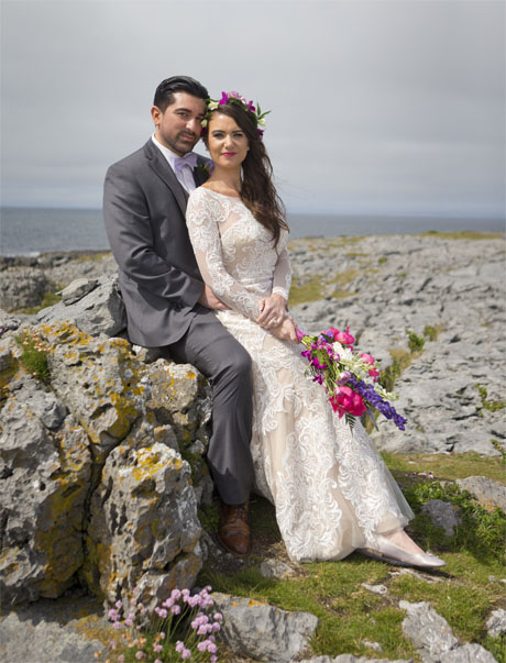 Beautiful bride with her groom in the Burren Co. Clare, on the west coast of Ireland.