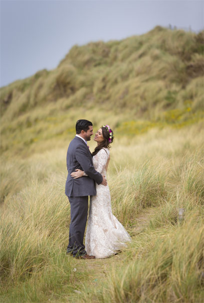 Bride & Groom in the dunes at Fanore beach Co. Clare, on the west coast of Ireland.