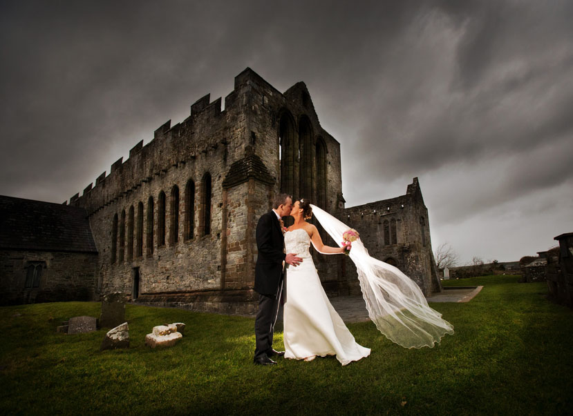 Bride and Groom pose for photographs at Ardfert Cathedral, before heading to Ballyroe Heights Hotel Tralee, Co. Kerry.