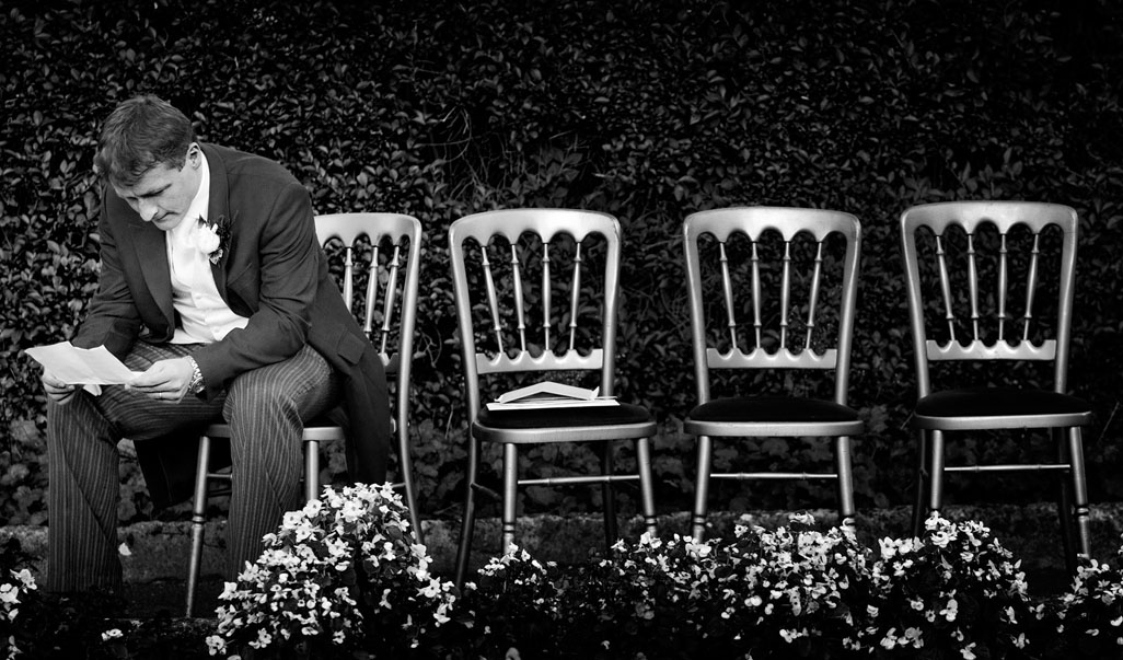 Best man going over his speech just before wedding reception at Dunraven Arms Hotel, Adare, Co. Limerick, Ireland.