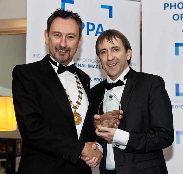 Cormac Receiving one of the awards from IPPA President Brendan Lyon at the IPPA National photographic awards 2015  at Ballsbridge Hotel Dublin